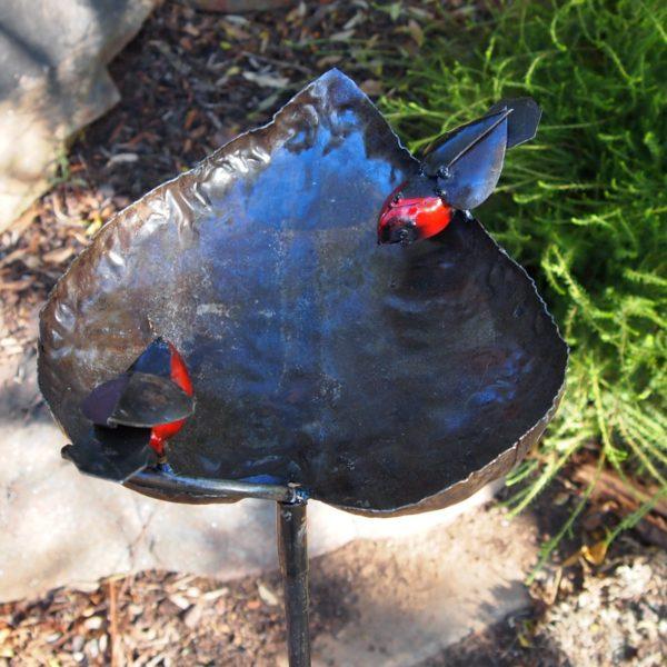Handcrafted metal bird feeder