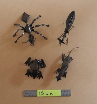 Collection of critters handmade from recycled metal
